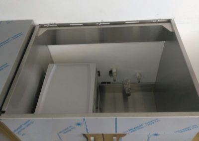 Roll out trash bin sink cabinet